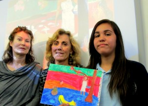 Community Volunteers Francesca Brunner and Jeanne Culkin (l. to r.) with Nativity seventh grader Alondra G. displaying her Gaughin replica in pastel.