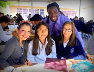 OInocente Izucar with Nativity students Jacqueline S. and Esmeralda O. and Mr. Trevor Crest, Nativity art teacher