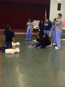 Nativity eighth graders participate in the basic CPR training, under the watchful eyes of graduate students from the Hahn School of Nursing at USD.